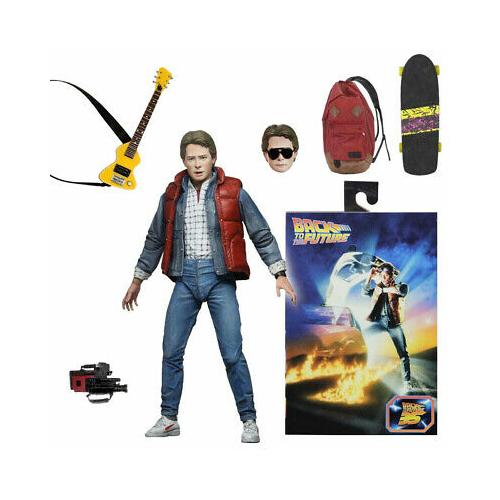 Back to the Future -Vissza a Jövőbe figura - Marty McFly 1985 Ultimate NECA figura gördeszkával, gitárral, kamerával, cserélhető fejekkel és extra-mozgatható végtagokkal  18 cm